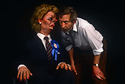 In the year of her being deposed in a leadership challenge is the satirical puppet of Margaret Thatcher with Spitting with Spitting Image co-creator Peter Fluck and wears a blue Conservative rosette and For Hire sticker on 20th March 1992, in London England. Peter Nigel Fluck is a caricaturist and one half of the partnership known as Fluck and Flaw with Roger Law, creators of the satirical TV puppet show Spitting Image.