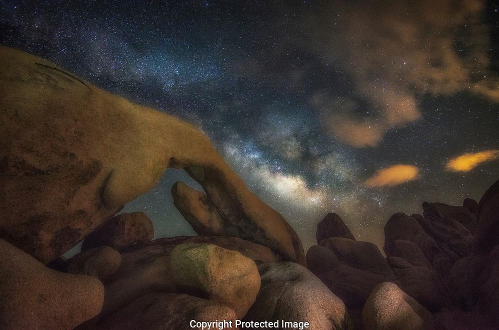 Milky Way over Arch Rock in Joshua Tree National Park, California.