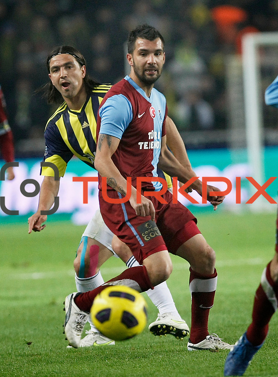 Fenerbahce's Mehmet TOPUZ (L) and Trabzonspor's Engin BAYTAR (R) during their Turkish superleague soccer derby match Fenerbahce between Trabzonspor at the Sukru Saracaoglu stadium in Istanbul Turkey on Sunday 30 January 2011. Photo by TURKPIX