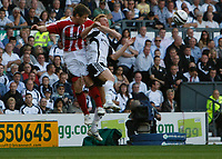 Photo: Steve Bond/Richard Lane Photography. Derby County v Sheffield United. Coca-Cola Championship. 13/09/2008. Gary Naysmith (L) gets a header in over Paul Green (R)