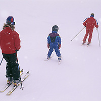 A family goes skiing in whiteout conditions.