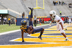Oct 3, 2020; Morgantown, West Virginia, USA; West Virginia Mountaineers wide receiver Bryce Ford-Wheaton (0) catches a pass for a touchdown during the first overtime against the Baylor Bears at Mountaineer Field at Milan Puskar Stadium. Mandatory Credit: Ben Queen-USA TODAY Sports