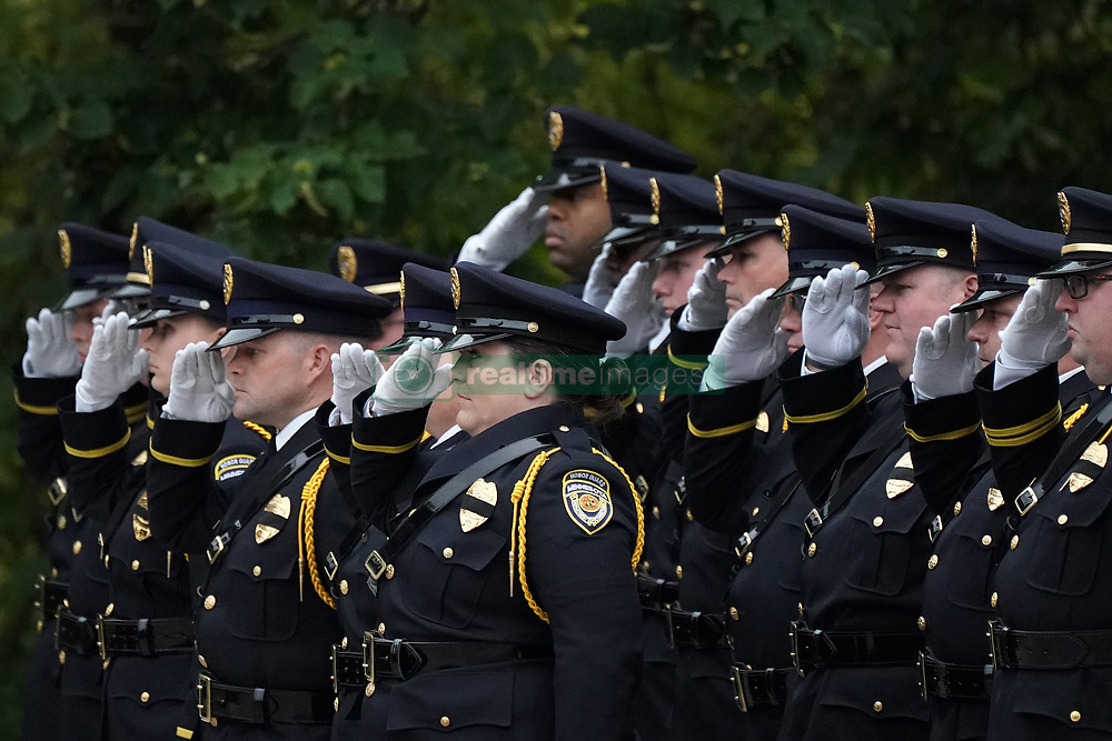 October 2, 2018 - Minneapolis, MN, USA - Officers stood at attention as fellow members of the Honor Guard marched out of Fort Snelling Memorial Chapel following Tuesday's funeral of Oak Park Heights correctional officer Joe Parise. ] ANTHONY SOUFFLE • anthony.souffle@startribune.com ....A funeral was held for Oak Park Heights correctional officer Joe Parise Tuesday, Oct. 2, 2018 at Fort Snelling Memorial Chapel in Minneapolis. Parise died on Sept. 24, shortly after rushing to rescue a colleague under attack from an inmate. It marks the second line-of-duty death of an officer since July. (Credit Image: © Anthony Souffle/Minneapolis Star Tribune via ZUMA Wire)