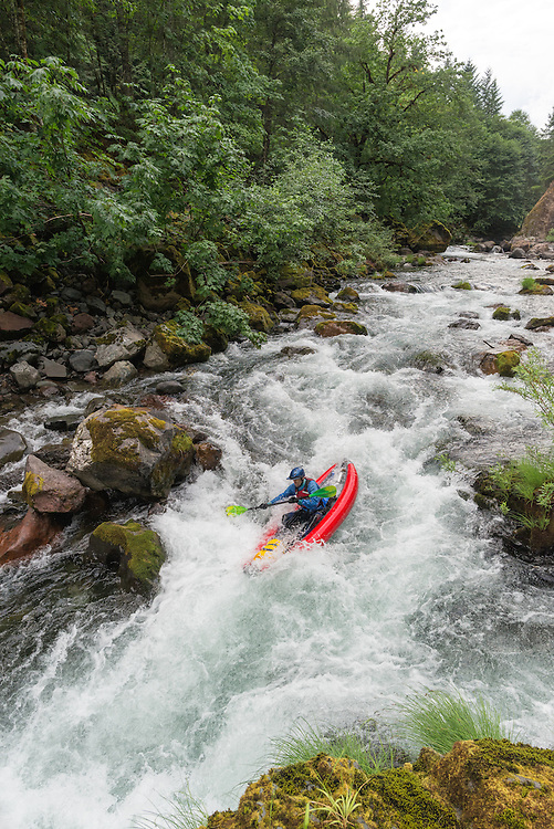 Paddling an inflatable kayak down the North Fork of the Middle Fork of the Willamette River, Oregon.