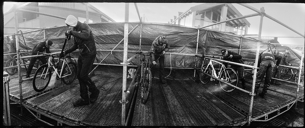 Washing station. If the course is muddy the riders change the bike more or less on every lap. The mechanics prepare the bike for the next change.