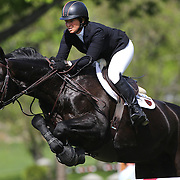 Beezie Madden riding Cortis 'C' in action during the $100,000 Empire State Grand Prix presented by the Kincade Group during the Old Salem Farm Spring Horse Show, North Salem, New York,  USA. 17th May 2015. Photo Tim Clayton
