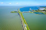 Nederland, Flevoland, Lelystad, 07-05-2015. Oostvaardersdijk, Houtribsluizen en begin van de Houtribdijk. Op de strekdam in de voorgrond de sculptuur 'Exposure' van de Britse kunstenaar Antony Gormley.<br /> Oostvaardersdijk, Houtrib locks and beginning of the Houtrib dike.<br /> luchtfoto (toeslag op standard tarieven);<br /> aerial photo (additional fee required);<br /> copyright foto/photo Siebe Swart