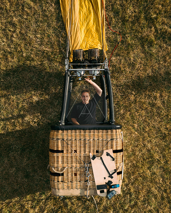 Aerial view of a person standing in hot air balloon basket gondola, Vilnius, Lithuania.