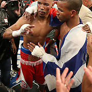 """Rances """"Kid Blast"""" Barthelemy (right) celebrates his victory over Argenis Mendez during the """"Judgement Day"""" boxing event at American Airlines Arena on Thursday, July 10, 2014 in Miami, Florida.  Barthelemy won the fight after 12 rounds. (AP Photo/Alex Menendez)"""
