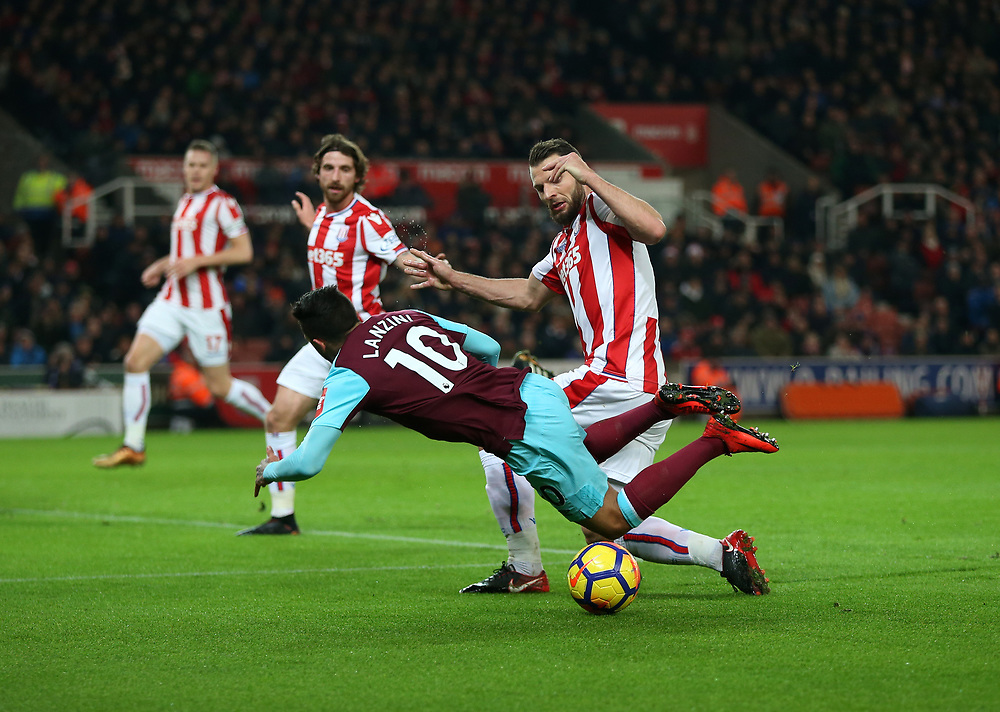 West Ham United's Manuel Lanzini is brought down by Stoke City's Erik Pieters to earn his side a penalty<br /> <br /> Photographer Rob Newell/CameraSport<br /> <br /> The Premier League - Stoke City v West Ham United - Saturday 16th December 2017 - Britannia Stadium - Stoke-on-Trent <br /> <br /> World Copyright © 2017 CameraSport. All rights reserved. 43 Linden Ave. Countesthorpe. Leicester. England. LE8 5PG - Tel: +44 (0) 116 277 4147 - admin@camerasport.com - www.camerasport.com