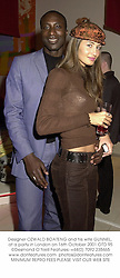 Designer OZWALD BOATENG and his wife GUNNEL, at a party in London on 16th October 2001.OTD 95