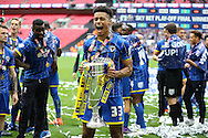 Lyle Taylor of AFC Wimbledon celebrates with the Sky Bet League 2 Play-off Trophy.Skybet football league two play off final match, AFC Wimbledon v Plymouth Argyle at Wembley Stadium in London on Monday 30th May 2016.<br /> pic by John Patrick Fletcher, Andrew Orchard sports photography.