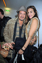 ADAM BRICUSSE and ZARA SIMON at the Prada Congo Art Party hosted by Miuccia Prada and Larry Gagosian at The Double Club, 7 Torrens Street, London EC1 on 10th February 2009.
