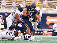 Dec 5, 2020; Berkeley, California, USA; California Golden Bears running back Christopher Brown Jr. (34) is brought down by the Oregon Ducks during the first quarter at California Memorial Stadium. Mandatory Credit: Kelley L Cox-USA TODAY Sports