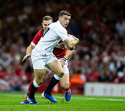 George Ford of England under pressure from George North of Wales<br /> <br /> Photographer Simon King/Replay Images<br /> <br /> Friendly - Wales v England - Saturday 17th August 2019 - Principality Stadium - Cardiff<br /> <br /> World Copyright © Replay Images . All rights reserved. info@replayimages.co.uk - http://replayimages.co.uk