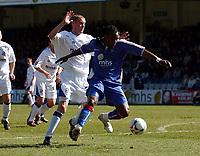 Photo: Olly Greenwood.<br />Gillingham v Huddersfield Town. Coca Cola League 1. 08/04/2006. Gillingham's Brent Sancho gets past Huddersfield's David Graham.