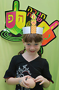 Hanukah celebration Preschool girl celebrating the Jewish festival of Chanukah