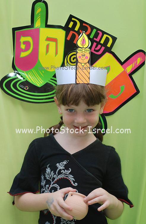 Hanukah celebration Preschool girl celebrating the Jewish festival of Chanukah