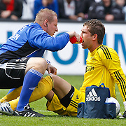 NLD/Rotterdam/20100919 - Voetbalwedstrijd Feyenoord - Ajax 2010, Ron Vlaar in botsing met keeper Maarten Stekelenburg en blesseert zichzelf daarbij