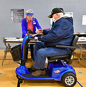 """Election judge Carleen Guthrie (left) helps William """"Crash"""" Simpson of Swansea at Christ Church in Fairview Heights as he prepares to vote at the 15th precinct polling place on Tuesday November 3, 2020 . The Vietnam veteran was a Senior Master Sergeant in the Air Force and saw action in Vietnam in 1972 and 1973.<br /> Photo by Tim Vizer"""