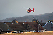 A Welsh Air Ambulance Helicopter arrives over the roof tops into Caerphilly to attend to a patient. Caerphilly, South Wales.  Wales Air Ambulance Charity (WAAC) is a Charity Air Ambulance service providing free, life-saving Helicopter Emergency Medical Service (HEMS) for the critically ill and injured of the UK and Wales.  (photo by Andrew Aitchison / In pictures via Getty Images)