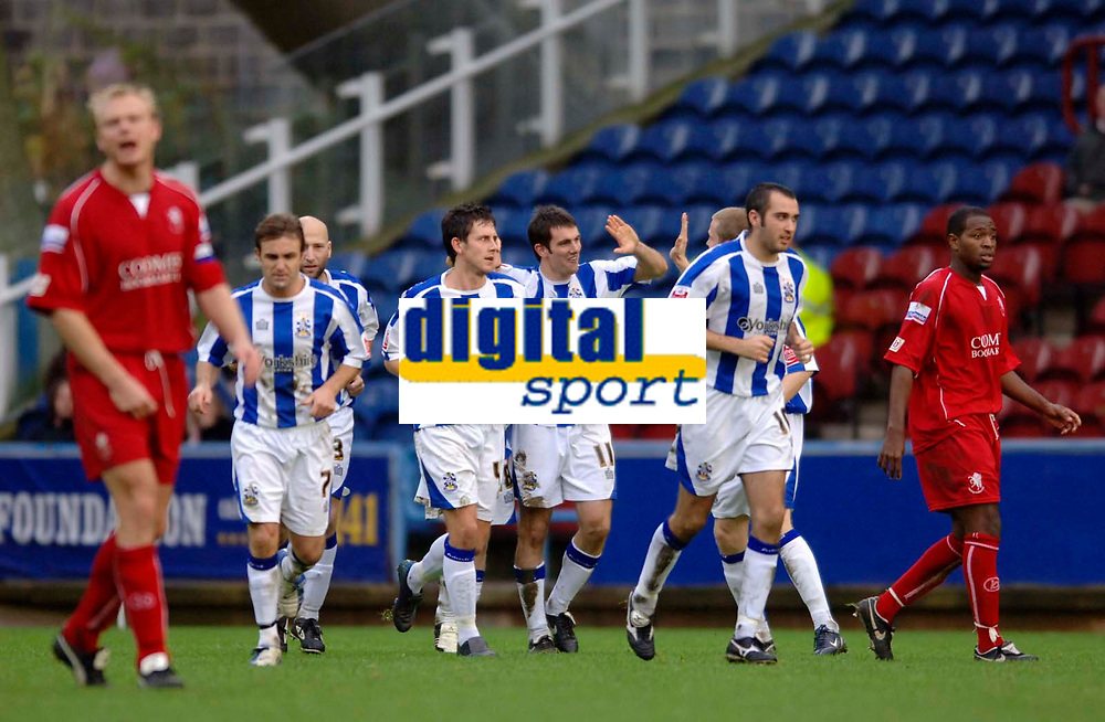 Photo: Glyn Thomas.<br />Huddersfield Town v Welling United. The FA Cup. 06/11/2005.<br />Huddersfield's Danny Schofield (C) is congratulated by teammates after scoring his team's second goal.