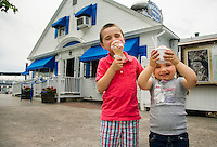 Two youngsters enjoy their ice cream cones from the Dockside Dairy Bar at the town docks in Wolfeboro, NH.  ©2106 Karen Bobotas Photographer
