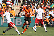 14 JUN 2010: Robin van Persie (NED) (9) slips between Martin Jorgensen (DEN) (10) and Lars Jacobsen (DEN) (6). The Netherlands National Team defeated the Denmark National Team 2-0 at Soccer City Stadium in Johannesburg, South Africa in a 2010 FIFA World Cup Group E match.