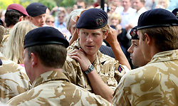 Prince Harry chats to fellow members of the Household Cavalry after a service of Remembrance for those who have died in Afghanistan at the Army Garrison Church in Windsor.