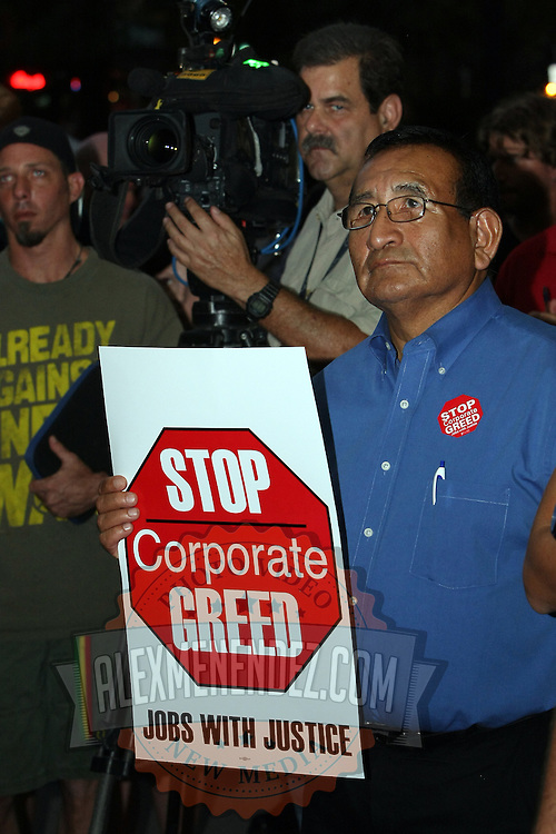 A supporter holds up a sign during an Occupy Orlando public demonstration in support of Occupy Wall Street gatherings across the country, at the Orange County History Center on Wednesday, October 5, 2011 in Orlando, Florida. (AP Photo/Alex Menendez)