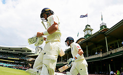 England's Tom Curran and Jonny Bairstow walk on for the second session during day five of the Ashes Test match at Sydney Cricket Ground.