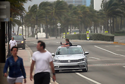 A passerby takes photos from a sunroof on Fort Lauderdale Beach as Hurricane Irma pushes into South Florida on Saturday, September 9, 2017, in Fort Lauderdale, FL, USA. Photo by Amy Beth Bennett/Sun Sentinel/TNS/ABACAPRESS.COM