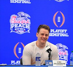 LSU Tigers quarterback Joe Burrow (9) during the post game press conference after the Tigers defeated the Oklahoma Sooners in the 2019 College Football Playoff Semifinal at the Chick-fil-A Peach Bowl on Saturday, Dec. 28, in Atlanta. (Harrison McClary via Abell Images for the Chick-fil-A Peach Bowl)
