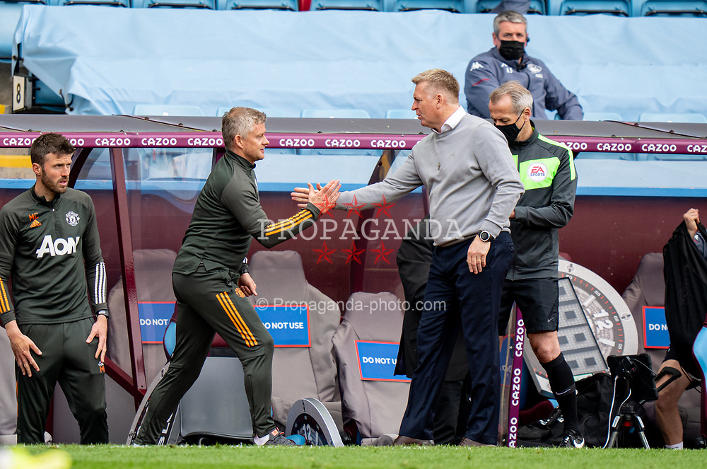 BIRMINGHAM, ENGLAND - Sunday, May 9, 2021: Manchester United's manager Ole Gunnar Solskjær (L) shakes hands with Aston Villa's manager Dean Smith after the FA Premier League match between Aston Villa FC and Manchester United FC at Villa Park. Manchester United won 3-1. (Pic by David Rawcliffe/Propaganda)