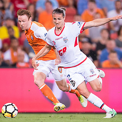 BRISBANE, AUSTRALIA - OCTOBER 13: Corey Brown of the Roar and Michael Marrone of Adelaide compete for the ball during the Round 2 Hyundai A-League match between Brisbane Roar and Adelaide United on October 13, 2017 in Brisbane, Australia. (Photo by Patrick Kearney)