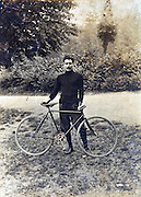 vintage portrait of adult man posing with race bicycle