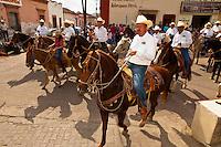Horseback riders parade around the town square on the Celebration of San Sebastian, Concordia (near Mazatlan), Sinaloa, Mexico
