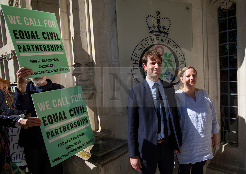 © Licensed to London News Pictures. 14/05/2018. London, UK. Rebecca Steinfeld (R) and Charles Keidan (2-R) arrive at the Supreme Court where they seek a change in the law that will allow heterosexual couples to enter into civil partnerships. Steinfeld and Keidan, who have 'deep-rooted' ideological objections to the institution of marriage, have previously lost their case at the High Court and the Court of Appeal. Photo credit: Rob Pinney/LNP