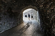 Visitors find light at the end of the tunnel in Stirling Castle. Once the capital of Scotland, Stirling is visually dominated by Stirling Castle, in the United Kingdom, Europe. Historically, Stirling controlled a strategic position (until the 1890s) as the lowest bridging point of the River Forth before it broadens towards the Firth of Forth, making it the gateway to the Scottish Highlands. One of the principal royal strongholds of the Kingdom of Scotland, Stirling was created a royal burgh by King David I in 1130. Stirling Castle sits atop Castle Hill, an intrusive crag, which forms part of the Stirling Sill geological formation. Most of the stronghold's main buildings date from the 1400s and 1500s, when it peaked in importance. The outer defences fronting the town date from the early 1700s. Before the union with England, Stirling Castle was also one of the most used of the many Scottish royal residences, serving as both a palace and a fortress. Several Scottish Kings and Queens have been crowned at Stirling, including Mary, Queen of Scots in 1542, and others were born or died there. Stirling Castle has suffered at least eight sieges, including several during the Wars of Scottish Independence, with the last being in 1746, when Bonnie Prince Charlie unsuccessfully tried to take the castle.