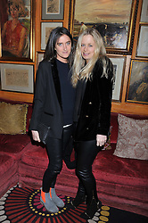 Left to right, VIOLET VON WESTENHOLZ and ASTRID HARBORD at the Johnnie Walker Blue Label and David Gandy partnership launch party held at Annabel's, 44 Berkeley Square, London on 5th February 2013.