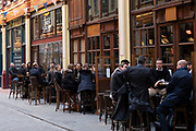People enjoying a drink at Leadenhall Market in the City of London as pubs reopen, serving customers outside as the national coronavirus lockdown three eases on 13th April 2021 in London, United Kingdom. Now that the roadmap for coming out of the national lockdown has been laid out, this is the first phase of the easing of restrictions.