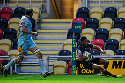 Dragons Winger (#11) Tonderai Chavhanga scores a try during the second half of the match - Photo mandatory by-line: Rogan Thomson/JMP - Tel: Mobile: 07966 386802 18/11/2012 - SPORT - RUGBY - Rodney Parade - Newport. Newport Gwent Dragons v Northampton Saints - LV= Cup Round 2