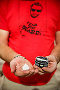 SHOT 10/17/16 10:34:39 AM - Tom Reynolds of Denver, Co. prepares to spread the ashes of friend Doug Pensinger near Musselman Arch on the White Rim Trail. The White Rim is a mountain biking trip in Canyonlands National Park just outside of Moab, Utah. The White Rim Road is a 71.2-mile-long unpaved four-wheel drive road that traverses the top of the White Rim Sandstone formation below the Island in the Sky mesa of Canyonlands National Park in southern Utah in the United States. The road was constructed in the 1950s by the Atomic Energy Commission to provide access for individual prospectors intent on mining uranium deposits for use in nuclear weapons production during the Cold War. Four-wheel drive vehicles and mountain bikes are the most common modes of transport though horseback riding and hiking are also permitted.<br /> (Photo by Marc Piscotty / © 2016)