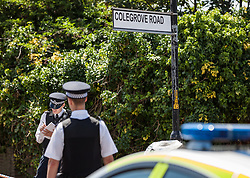 © Licensed to London News Pictures. 06/08/2016. London, UK. Police on Colegrove Road in Peckham where a 16-year-old boy was stabbed to death on the evening of Friday 5 August 2016. Police have launched a murder investigation. Photo credit: Rob Pinney/LNP