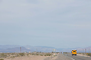 School bus on South Highway, Amargosa, Nevada. Each school day nearly half a million school buses transport 30 million children to and from school and school-related activities; over half of the United States