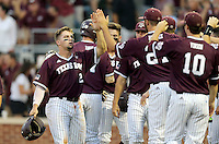 Texas A&M's Ryne Birk (2) celebrates with teammates after scoring a run against TCU during the 1st inning of a NCAA college baseball super regional tournament game, Friday, June 10, 2016, in College Station, Texas. (AP Photo/Sam Craft)