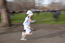 © Licensed to London News Pictures. 21/02/2012. LONDON, UK. Conservative MP Tracey Crouch sprints during the annual pancake race outside the Houses of Parliament today (21/02/12). Lords, Members of Parliament and political journalists today took part in the 2012 'Rehab Parliamentary Pancake Race' in aid of disability charity Rehab. The parliamentary team took the trophy after an extra lap was run due to widespread cheating. Photo credit: Matt Cetti-Roberts/LNP