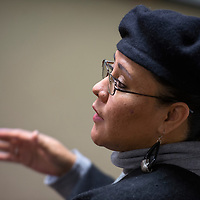 021315       Cable Hoover<br /> <br /> Shirlene Rogers-Cheromiah shares a personal story during a discussion on homelessness Friday at the Octavia Fellin Public Library in Gallup.