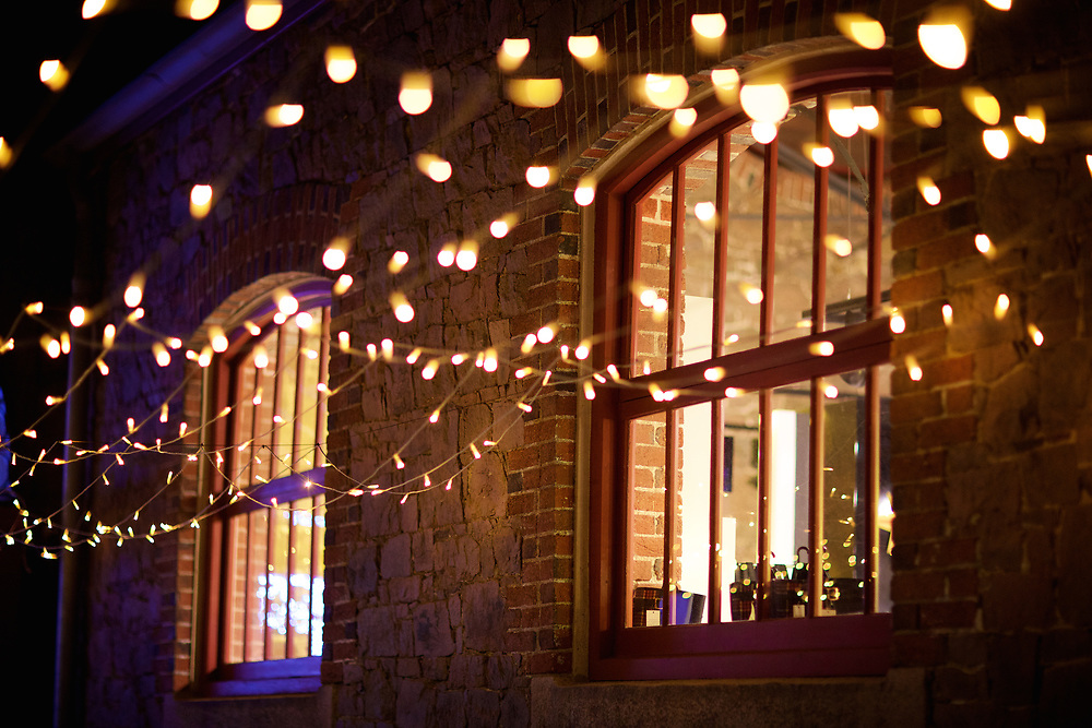 Festive fairy Christmas lights outside the windows at Liberty Wharf in St Helier, Jersey, Channel Islands