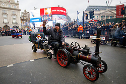 © Licensed to London News Pictures. 01/01/2017. London, UK. Steam cars participate in London's New Year's Day Parade, the event is one of the world's great street spectaculars with up to 10,000 performers from around the world and hosts marching bands, cheerleaders, leading companies, unions and local boroughs celebrating the arrival of 2017. Photo credit: Tolga Akmen/LNP